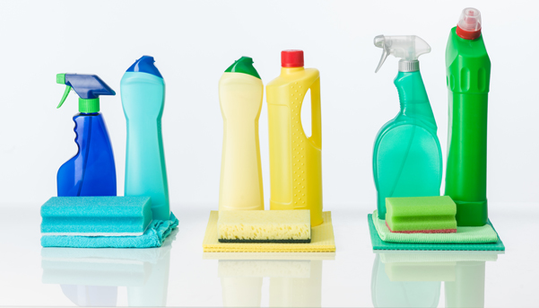 household cleaning supplies arranged by color, on white background