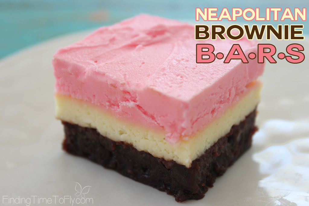 Neapolitan brownie bars with a cheesecake layer and strawberry frosting. YUM!