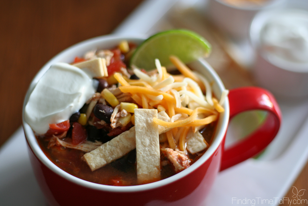 This is my kind of recipe! Nothing to prep, and I don't even have to remember to thaw the chicken. Slow Cooker Chicken Tortilla Soup is great for busy week night dinners.
