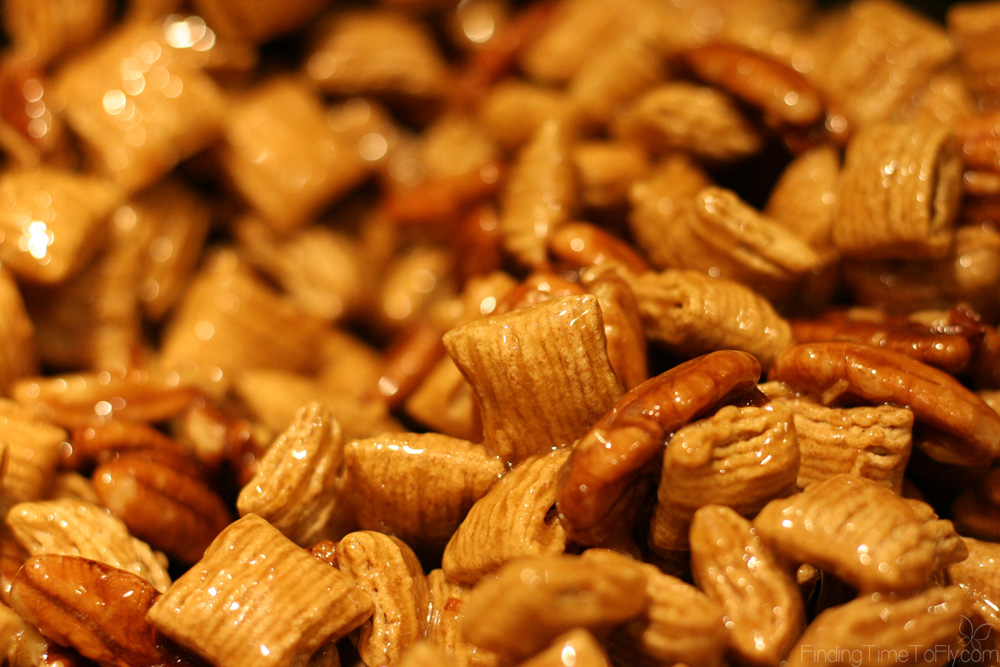 Caramel Pecan Snack Mix makes a great gift for teachers or neighbors. Quaker Oatmeal Squares cereal and pecan halves coated in a caramel glaze. Yum!